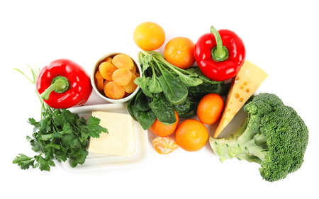 Fresh products rich in vitamin A on white background, top view Foto de archivo