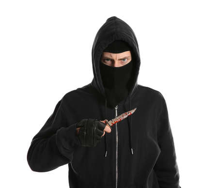 Man in mask with bloody knife on white background. Dangerous criminal