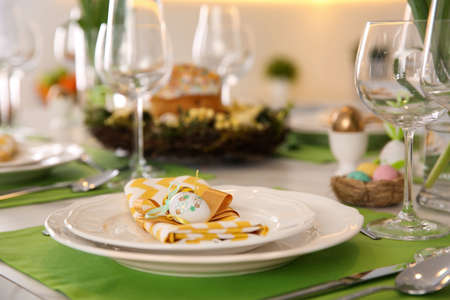 Festive Easter table setting with eggs, closeup