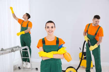 Team of professional janitors cleaning room after renovation Reklamní fotografie