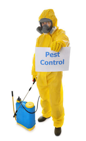 Man wearing protective suit with insecticide sprayer and sign PEST CONTROL on white background