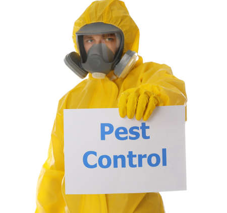 Man wearing protective suit holding sign PEST CONTROL on white background