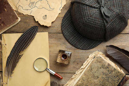 Composition with different vintage items on wooden background. Detective layout Archivio Fotografico