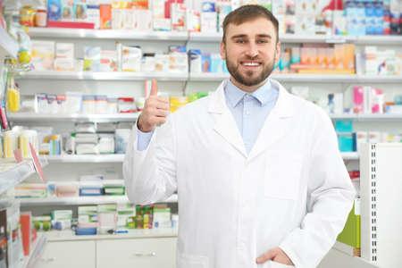 Portrait of professional pharmacist in modern drugstore