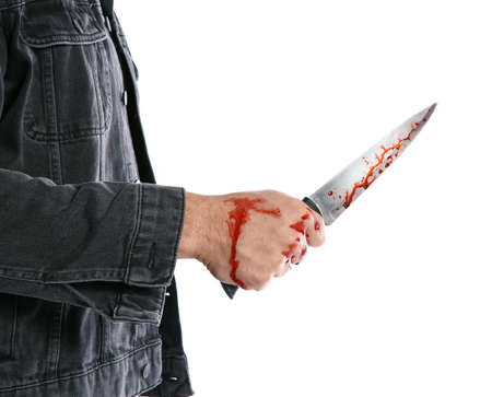 Man with bloody knife on white background, closeup. Dangerous criminal
