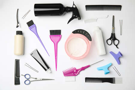 Professional tools for hair dyeing on white background, flat lay