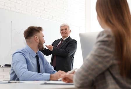 Senior business trainer working with people in office Zdjęcie Seryjne