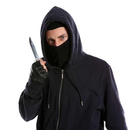Man in mask with knife on white background. Dangerous criminal Foto de archivo