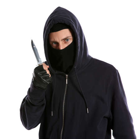 Man in mask with knife on white background. Dangerous criminal