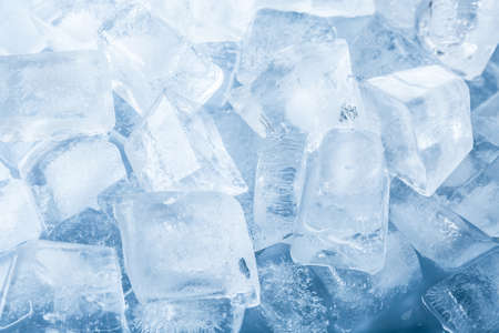 Crystal clear ice cubes as background, top view Imagens