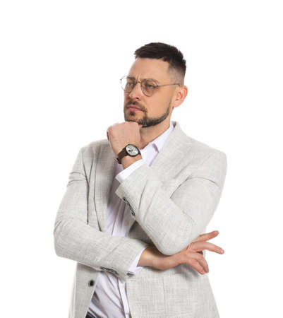 Confident businessman in glasses on white background