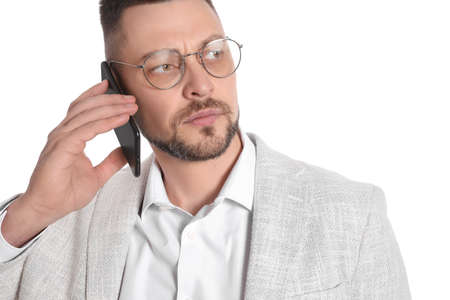 Businessman in glasses talking on smartphone against white background, closeup 版權商用圖片 - 142674659
