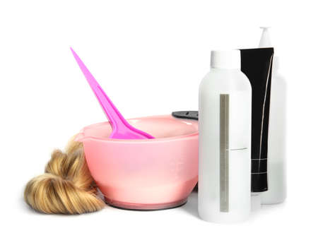 Professional tools for hair dyeing on white background