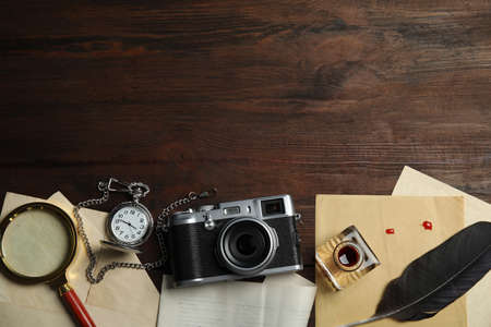 Composition with different vintage items on wooden background, space for text. Detective layout