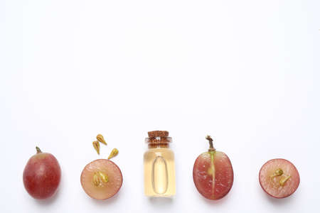 Composition with natural grape seed oil on white background, top view. Organic cosmetic Фото со стока