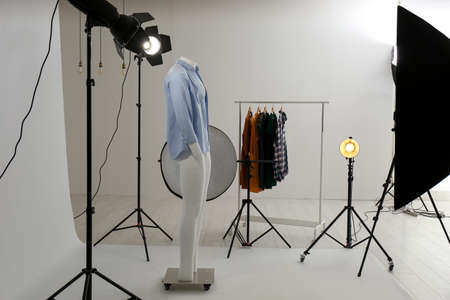 Ghost mannequin with modern clothes in professional photo studio