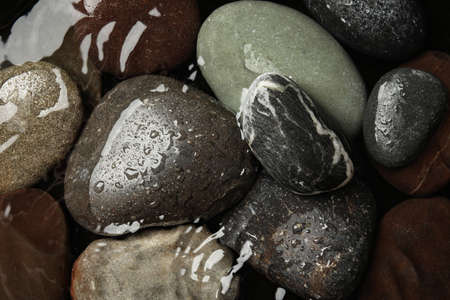 Pile of stones in water as background, top view. Zen lifestyle