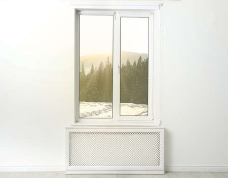 Beautiful view of snowy forest through big window