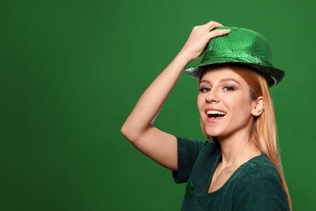 Young woman in green outfit on color background, space for text. St. Patricks Day celebration Zdjęcie Seryjne