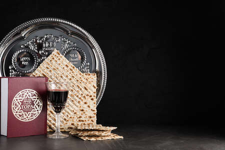 Symbolic Pesach (Passover Seder) items on black table, space for text Standard-Bild