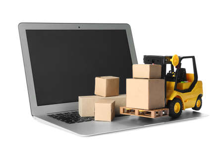 Laptop, forklift model and carton boxes on white background. Courier service