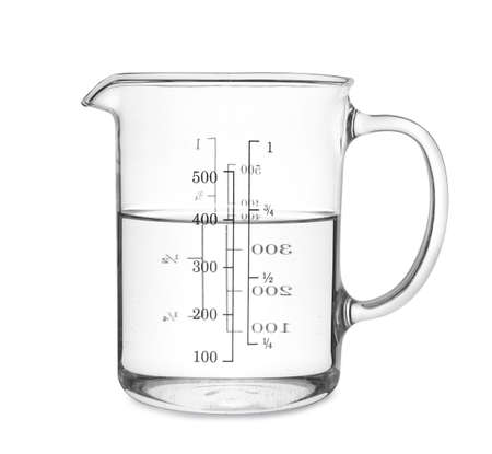 Measuring cup with clear water isolated on white Zdjęcie Seryjne