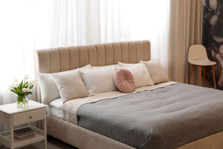 Beautiful room interior with large comfortable bed