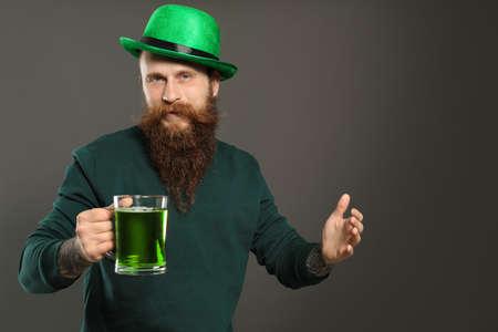Man with green beer on grey background. St. Patricks Day celebration Zdjęcie Seryjne