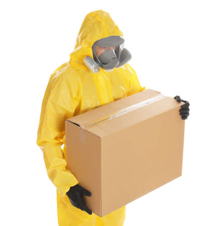 Man wearing chemical protective suit with cardboard box on white background. Prevention of virus spread