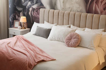 Large comfortable bed in beautiful room interior
