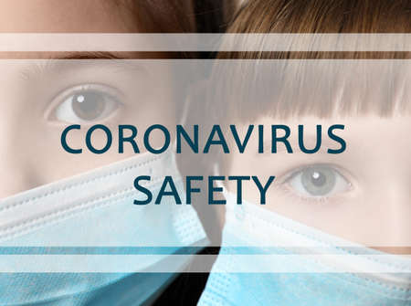 Little girls with medical masks, closeup. Coronavirus safety
