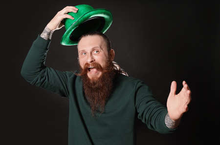 Bearded man with green hat on black background. St. Patricks Day celebration Zdjęcie Seryjne