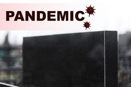 Black granite tombstone outdoors, closeup. Outbreak of pandemic disease