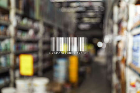 Barcode and blurred view of modern wholesale warehouse