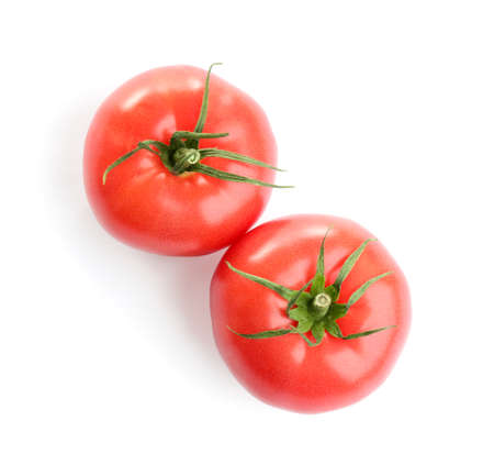 Fresh ripe organic tomatoes isolated on white, top view