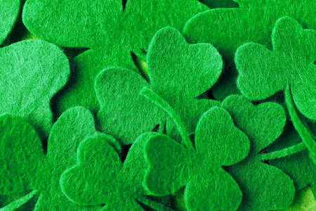 Green clover leaves as background, top view. St. Patricks Day celebration
