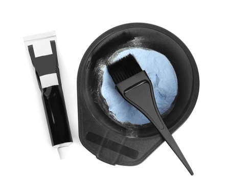 Professional tools for hair dyeing on white background, top view