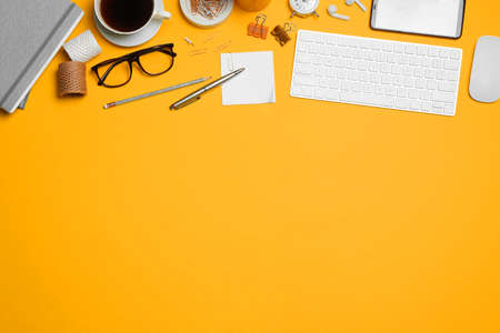 Flat lay composition with computer accessories and different office items on orange background. Space for text 版權商用圖片