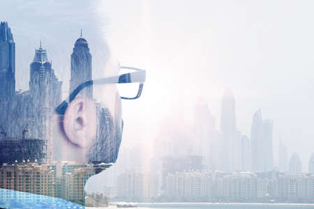 Double exposure of businessman and city landscape Imagens