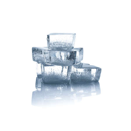 Crystal clear ice cubes isolated on white Banco de Imagens
