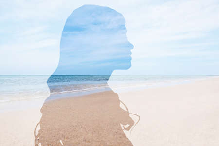 Double exposure with silhouette of woman and sea landscape. Concept of psychological health 写真素材