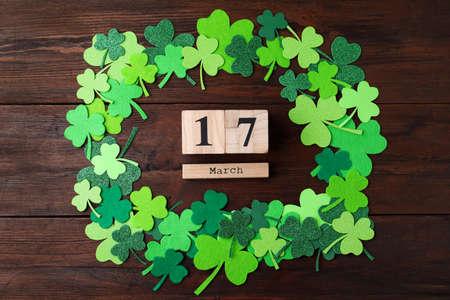 Flat lay composition with block calendar on wooden background. St. Patricks Day celebration Zdjęcie Seryjne