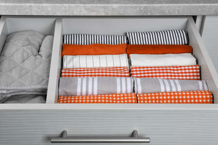 Towels with pattern and orange in drawer