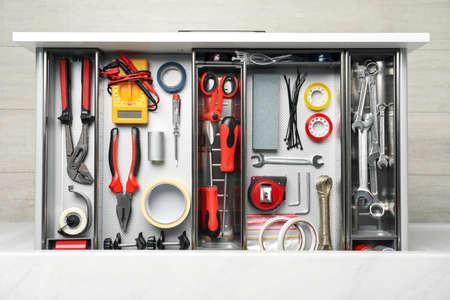 Set of instruments in open desk drawer, top view Archivio Fotografico