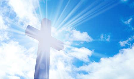 Silhouette of cross against blue sky. Christian religion