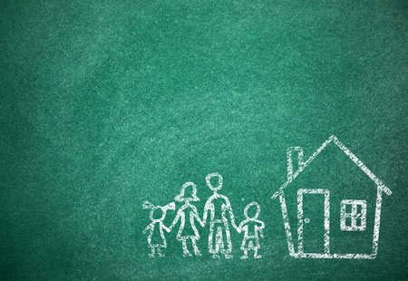 House and family drawn with chalk on school board