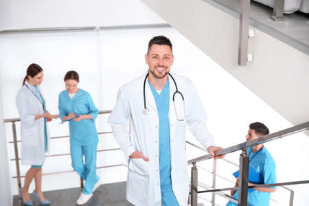Male doctor going upstairs in modern clinic