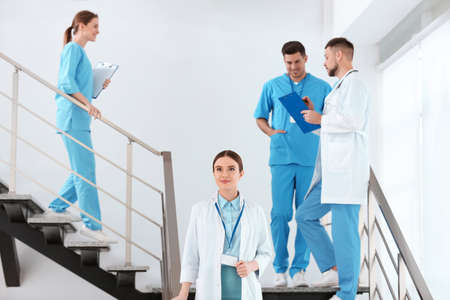 Team of professional doctors on staircase in clinic 版權商用圖片