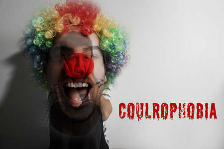 Coulrophobia concept. Double exposure of scared little boy and clown Stock Photo