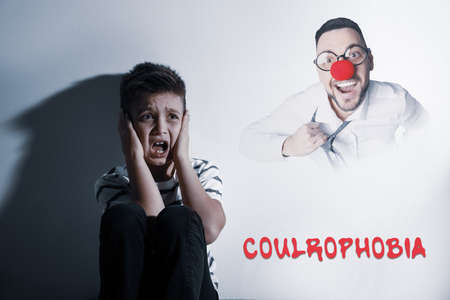 Coulrophobia concept. Scared little boy and phantom of clown